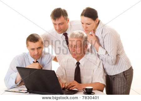 Four Businessmen Working