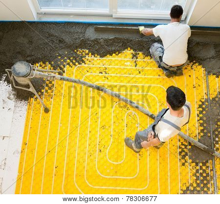 Installing underfloor heating and colling pipes modern system