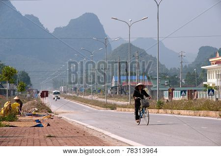 Vietnamese Riding Bicycle Alone In Border City.