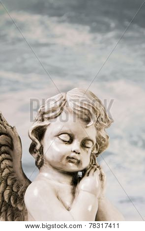 Sad sleeping angel. Idea for a mourning background.