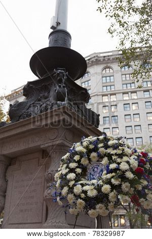 NEW YORK - NOV 11, 2014: United War Veterans Council floral wreath of blue and white placed by the Eternal Light Flagstaff monument in Madison Square Park on Veterans Day in Manhattan on Nov 11, 2014.