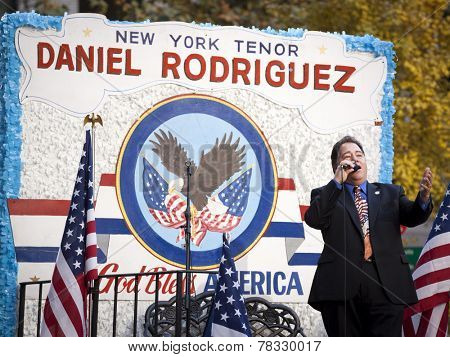 NEW YORK - NOV 11, 2014: New York tenor Daniel Rodriguez sings from a parade float during the 2014 America's Parade held on Veterans Day in New York City on November 11, 2014.