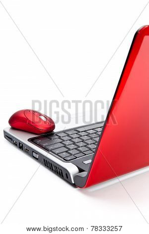 Red computer mouse and red notebook.Still-life on a white background