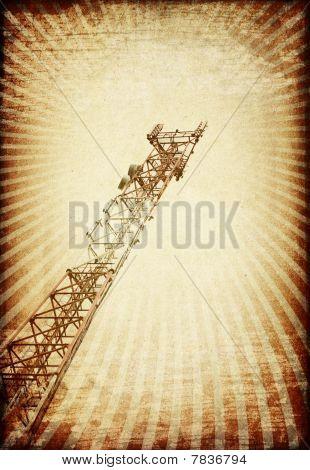 Grunge Transmitter Tower Against Sunburst Image.