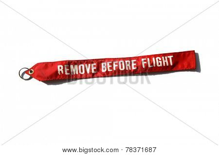 Remove before flight is a safety warning commonly seen on removable aircraft and spacecraft components, typically in the form of a red ribbon. A very important reminder before taking off into the sky