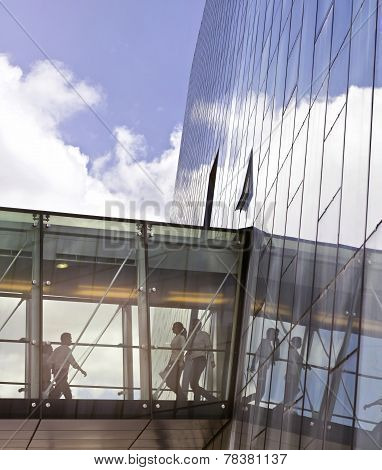 Business People Using A Transition Of A Contemporary Office Building
