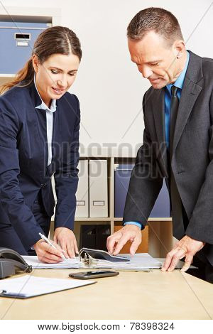 Employees of a bank doing financial calculation for a mortage