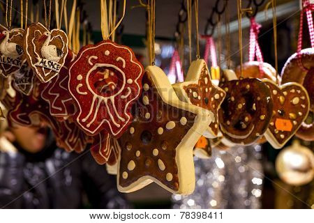 Gingerbread cookies hanging from market stall