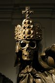 Crowned skeleton in the ancient emperor tombs Kaisergruft in Vienna, Austria.                 poster