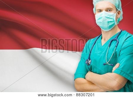 Surgeon with national flag on background - Monaco poster