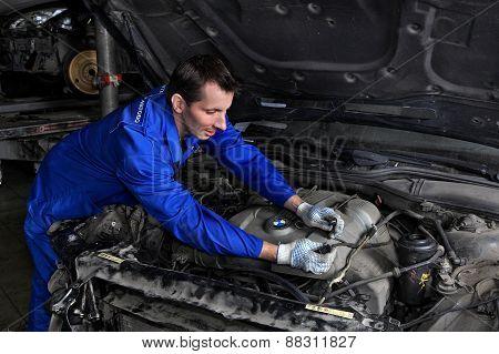 Auto Mechanic Repairing A Car Engine.
