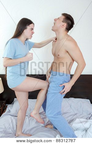 Angry Woman In Panties Kicking With Leg Handsome Half Naked Man In Groin