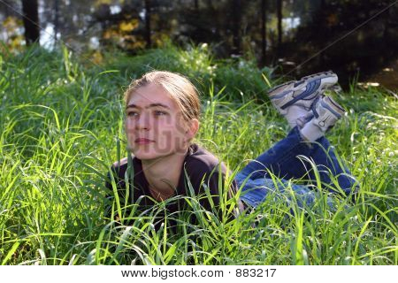 Girl Has A Rest In A Grass