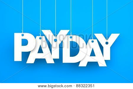Payday word - suspended by ropes on blue background