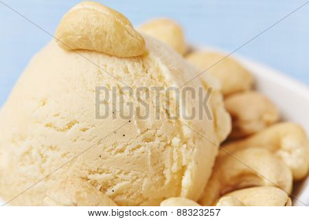 Scoop of cashew ice cream with many cashew nuts