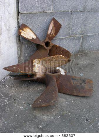 Rusty Old Ship Screws On Quay