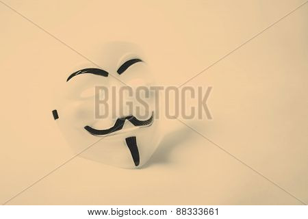 white anonymous mask on white background retro style