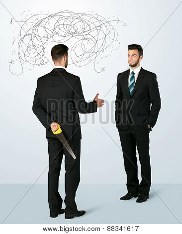 Ruthless businessman hiding a weapon and weaving plan around his head