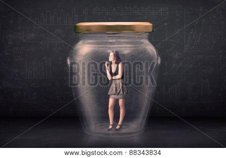 Businesswoman shut inside a glass jar concept concept on background
