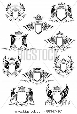 Heraldic winged shields with crowns and ribbon banners