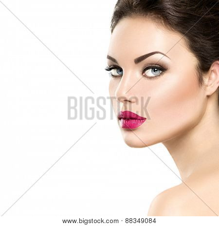 Beauty woman face closeup isolated on white background. Beautiful model girl makeup. Gorgeous lady with blue eyes and brown hair. Perfect skin. Professional make up. Red lips