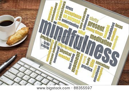 mindfulness word cloud on a laptop with a cup of coffee