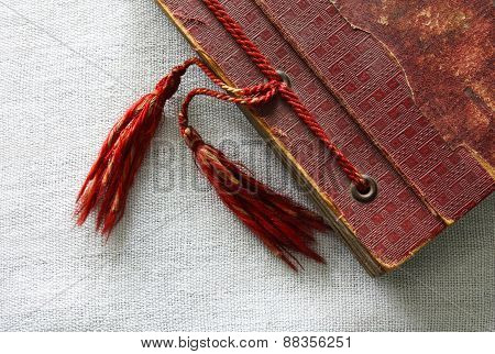 Old red photo album with tassels