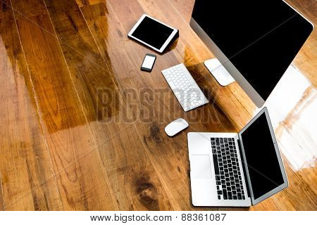 Computer ,laptop , tablet , smart phone on wood table  ( with 4 layer clipping path : Phone,Laptop,Pad and  pc screen)