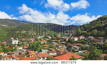 Panoramic view of mountain village with church