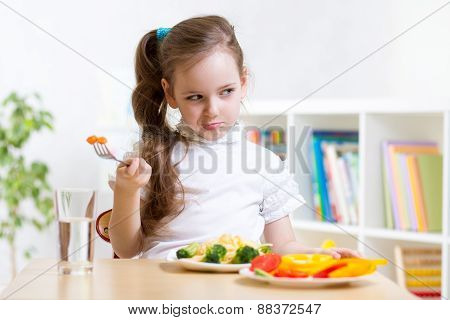 pretty kid girl refusing to eat her dinner healthy vegetables poster