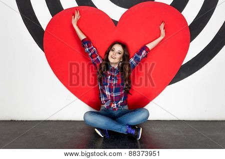 Concept Photo Of Happy Woman Sitting On Floor With Big Red Heart