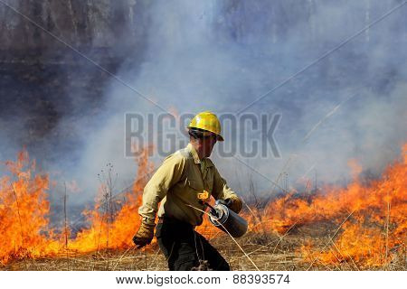 Forester Starting a Controlled Prairie Burn.
