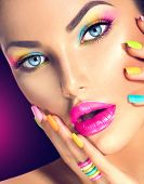Beauty Girl face with Vivid Makeup and colorful Nail polish. Colourful nails. Fashion Woman portrait close up. Bright Colors. Blue eyes, long eyelashes, vivid eyeshadows Rainbow make up poster
