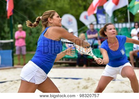 MOSCOW, RUSSIA - JULY 16, 2015: Evangelia Tsavou (left) and Eleni Eirini Papavasileiou of Greece in the match of the ITF Beach Tennis World Team Championship against Russia. Russia won 3-0