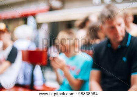 Blurred Colorful Bokeh Background With Unrecognisable People