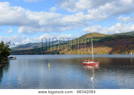 Lake Tremblant and Mont-Tremblant village in fall with fall foliage, Town of Mont-Tremblant, Quebec, Canada. poster
