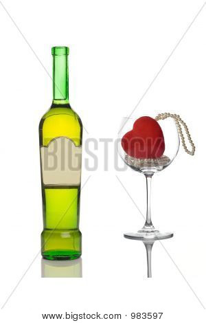 Wine Bottle And An Empty Glass