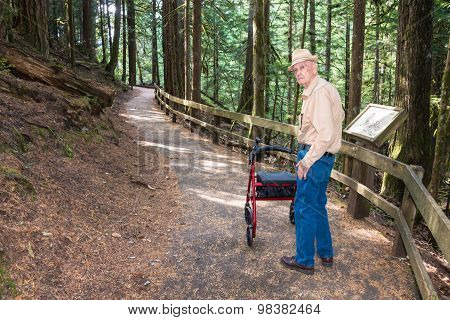 Active Senior Male Hiking with Walker