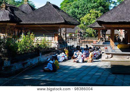 People praying in Turta Empul temple in Bali, Indonesia.