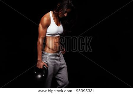 Young Fit Woman Holding Kettle Bell