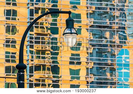 A streetlight on the background of glass facade of skyscraper with reflection of another one Atlanta USA