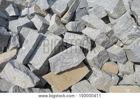 Pile of gray color stones for building the house. Background with pile of rectangular shaped stones
