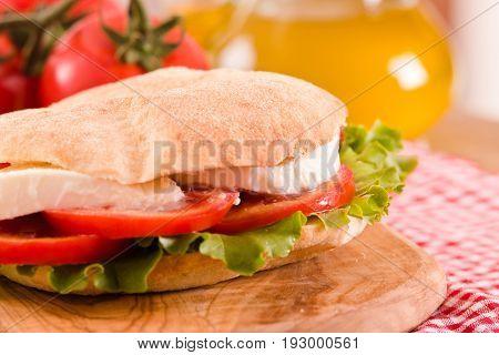 Puccia bread with mozzarella lettuce and tomato.