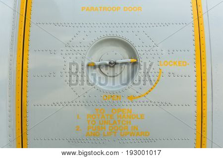 Close up paratroop door on military transport aircraft