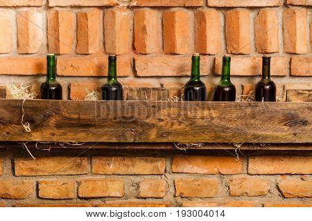 wine bottles on the wooden shelf in cellar
