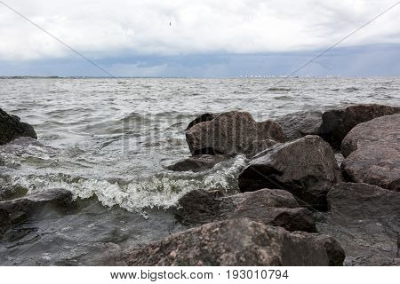 sea wave is incident on rocks coast Gulf of Finland