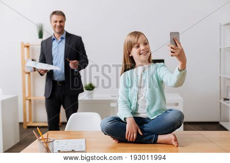 I got you. Pretty sincere inspired girl sending mom a message and telling her about the day at dads office while making a selfie