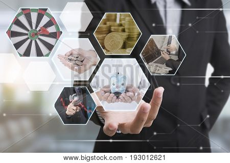 Business hand with finance interface and globe networking system. concept technology social network communication.