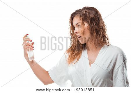 Beautiful Blonde Woman In Bathrobe Holding Hairspray Isolated On White