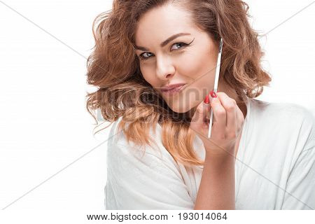 Portrait Of Smiling Woman Holding Eyeliner And Looking At Camera Isolated On White